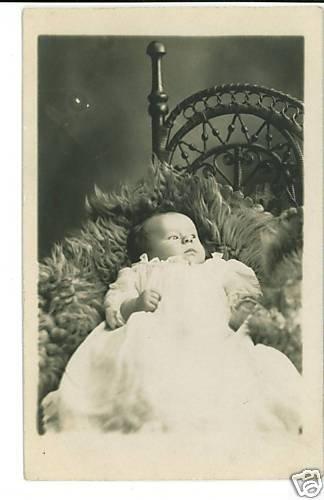 RPPC BABY ON FUR BLANKET WICKER CHAIR MILON HARRY KLOTZ