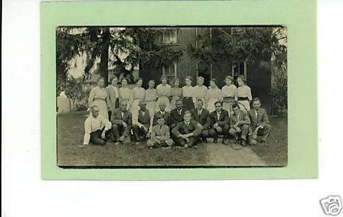 RPPC SEVERAL MEN AND WOMEN OUTSIDE BRICK HOUSE