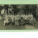RPPC SEVERAL MEN AND WOMEN OUTSIDE BRICK HOUSE