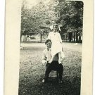 RPPC BOY ON CHAIR GIRL SITTING ON HIS SHOULDER OUTSIDE