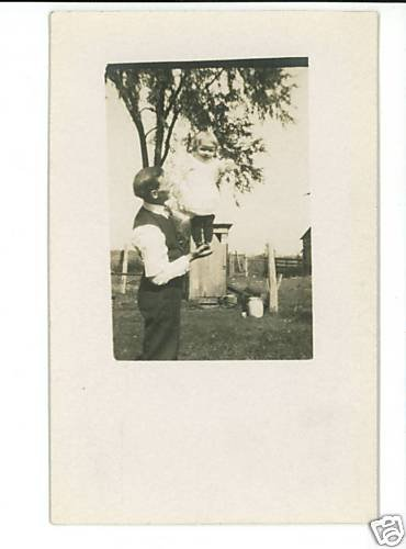 RPPC MAN HOLDING BABY GIRL FARM SCENE OUTHOUSE