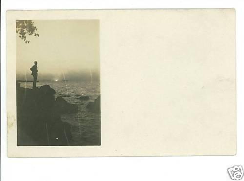 MAN SILHOUETTE REAL PHOTO POSTCARD SUNSET WATER ROCKS