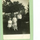 RPPC 4 CHILDREN 3 GIRLS 1 BOY FARMHOUSE SCHWAN'S STUDIO