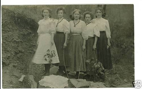 RPPC FIVE YOUNG WOMEN HOLDING STICKS BEAUTIFUL DRESSES