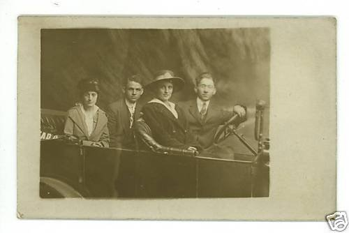 RPPC TWO COUPLES IN AN OLD  CAR