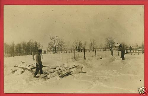 RPPC TWO MEN HUNTING WITH GUNS RIFLES SHOTGUNS IN SNOW