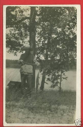 RPPC MAN FISHING W/FISH ON STRINGER  LARGE BRIMMED HAT