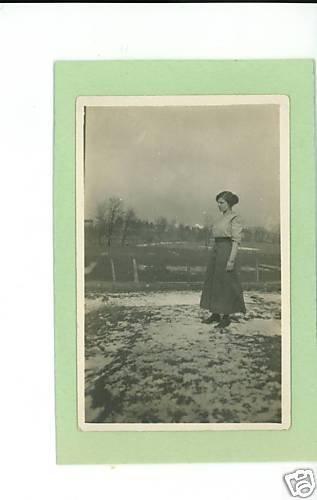 WOMAN OUTSIDE IN SKIRT & BLOUSE IN SNOWY FIELD RPPC