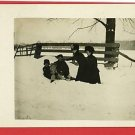 RPPC WOMEN AND CHILDREN IN SNOWBANK FUR HATS FENCE