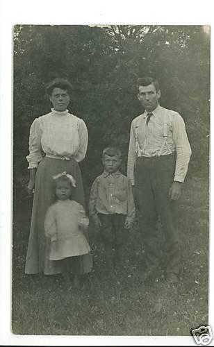 RPPC FAMILY WOMAN MAN BOY GIRL  SUSPENDERS  BOW IN HAIR