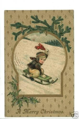 CHRISTMAS BOY SLEDDING SLED 1910  POSTCARD