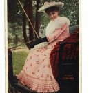 WOMAN IN BUGGY PINK DRESS HAT BLANKET WHIP POSTCARD