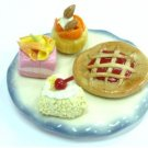 Mini Cake and tart on White and blue plate NBR99