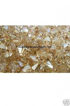 25 Pcs 4MM Crystal Golden Shadow Swarovski 5301 Bicone