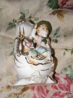 Porcelain Figurine with Vase trimmed in Liquid Gold