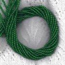 Green Emerald Preciosa 4mm Czech Pressed GlassStrand of Round Beads