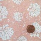 White Seashells on Peach Fabric