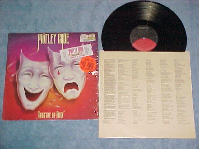MOTLEY CRUE--THEATRE OF PAIN--VG+/NM LP--ticket sticker