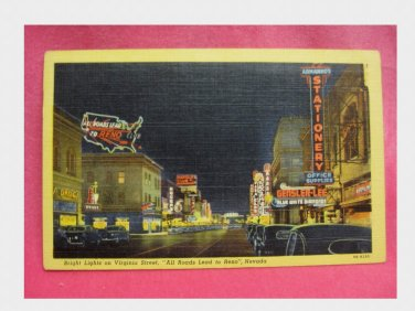 Vintage Linen Postcard - Night Time on Virginia Street in Reno
