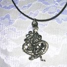 HUGE SNAKE IN A PILE OF HUMAN SKULLS CAST PEWTER PENDANT ADJ STRING NECKLACE