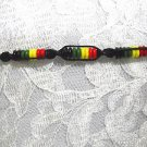 BLACK MACRAME SPIRAL RASTA RED GREEN YELLOW TIE ON BRACELET OR ANKLET 7 - 11""