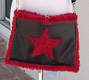 Tripp NYC reversible fur handbag star purse
