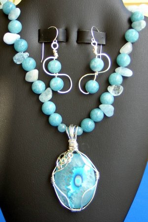 AquaMarine Necklace with Sterling Silver wrapped dyed Quartz pendant.