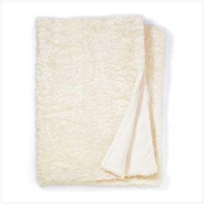 WHITE FULL SIZE FAUX-FUR BLANKET  Retail: $119.95