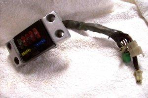 83 VT500 SHADOW HANDLEBAR COVER CLAMP & fuse box assemb