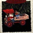 Hallmark Ornament ~ Happy Haul-idays 1993  ~ Here Comes Santa series
