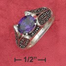 SYNTHETIC TANZANITE W/MARCASITE ENCRUSTED TAPERING BAND RING.