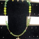 """""""Left-Handed"""" Gold and Green Necklace with Flower Charm"""