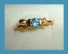 Gorgeous Round Cut London Blue Topaz CZ & Bow Shaped Gold Tone Ring