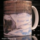 Ceramic mug printed with Monet's Cat Sleeping on a Bed