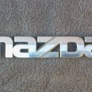 OEM Mazda Body/Dash/Trunk Emblem. 15.8cm
