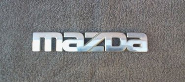OEM Mazda Body/Dash/Trunk Emblem. 15.8cm