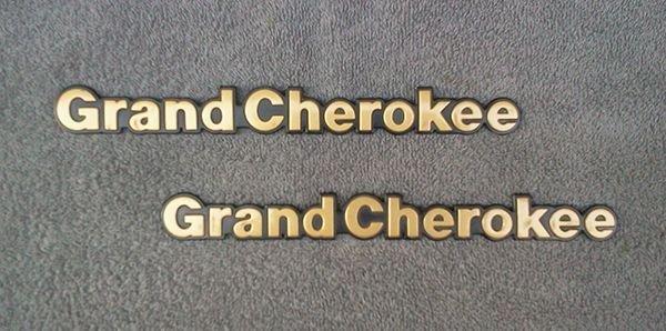 OEM Jeep Grand Cherokee Body/Dash Emblems. RARE Gold Color!