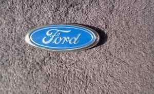 Ford Body/Dash Emblem EXCELLENT Condition  3 1/2 inches long. Pin/glue attach