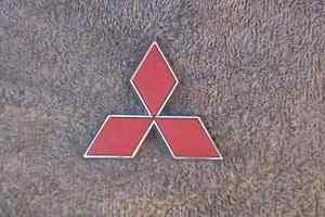 OEM Mitsubishi Body/Dash Emblem. Red 7.5cm