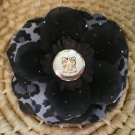 Black rose with leopard print and silver button