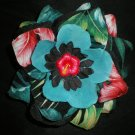 Black and turquoise rose with tropical print and flower center