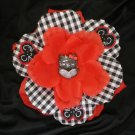 Red rose with gingham print and black cat center