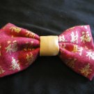 Brick red bow w/ gold Asian writing