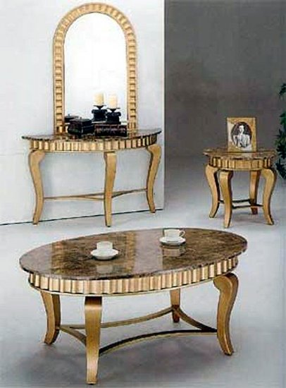 Marble top coffee table in gold finish. Other pieces sold separa