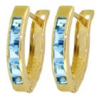 DD-1049 14K Solid gold oval huggie earring with blue topaz