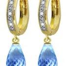 DD-3408W: 14K. WHITE GOLD DIAMONDS HUGGIE EARRING WITH BLUE TOPAZ