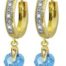 BLUE TOPAZ & DIAMOND HUGGIE EARRINGS IN I4K YELLOW GOLD