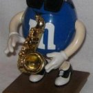 COLLECTIBLE M&M SAXAPHONE PLAYER BLUE WITH SUN GLASSES
