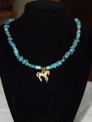 Turquois bead choker with gold horse pendant