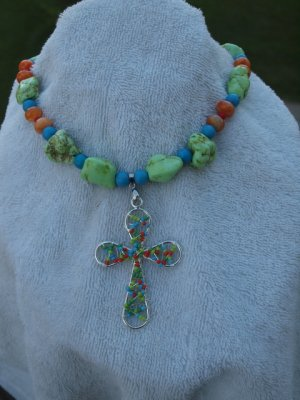 Multi colored cross with matching beads